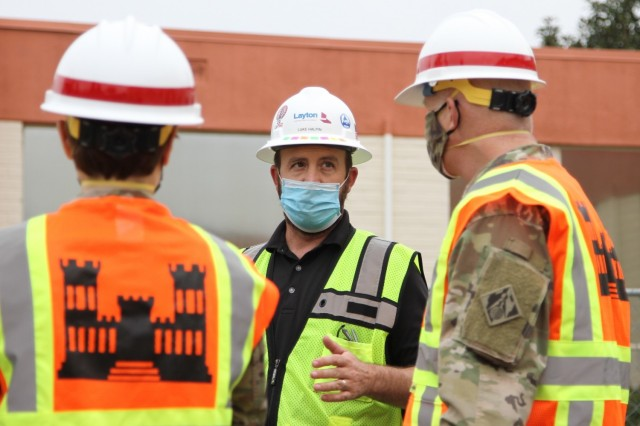 Luke Halpin, construction manager with Layton Construction Company, center, talks with Brig. Gen. Paul Owen, U.S. Army Corps of Engineers South Pacific Division commander, right, during Owen's Feb. 9, 2021 visit to Beverly Community Hospital in Montebello, California, to see construction progress there, including upgrades to a 17-bed wing in the facility for non-COVID patients and the conversion of a pre-operation waiting room to a COVID staging area through the addition of high-flow oxygen. At left is Col. Julie Balten, Los Angeles District commander.