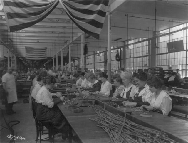 Women inspect pistol parts at Colt's Patent Fire Arms Plant