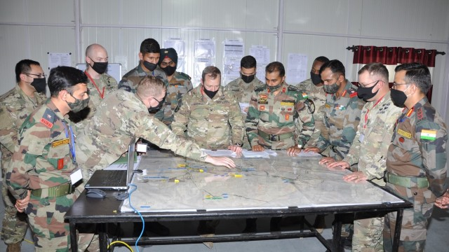 Commanders and staff from the Indian Army's 170th Infantry Brigade and the U.S. Army's 1-2 Stryker Brigade discuss operations during a command post exercise as part of Yudh Abhyas, Feb. 19, 2021 in India. Now in its 16th year, Yudh Abhyas builds on the enduring Indian-U.S. partnership through 14 days of combined field training, cultural exchange and a brigade-level command post exercise, leading to greater interoperability between the two nations, in support of a free and open Indo-Pacific. (Photo courtesy of Indian Army)