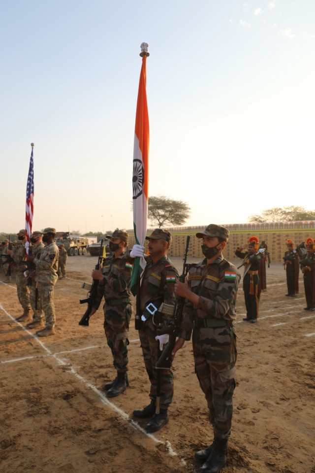 Soldiers of the Indian and U.S. armies mark the conclusion of Exercise Yudh Abhyas, Feb. 21, 2021 in India. Now in its 16th year, Yudh Abhyas builds on the enduring Indian-U.S. partnership through 14 days of combined field training, cultural exchange and a brigade-level command post exercise, leading to greater interoperability between the two nations, in support of a free and open Indo-Pacific. (Photo by Staff Sgt. Joe Tolliver, 1-2 Stryker Brigade Combat Team public affairs)