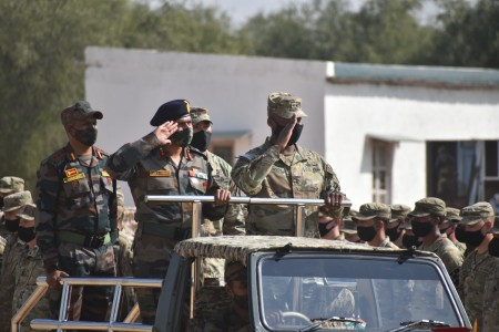 Commanding generals of the Indian Army's 24th Infantry Div. and U.S. Army's 7th Infantry Div. review the troops at the conclusion of Exercise Yudh Abhyas, Feb. 21, 2021 in India. Now in its 16th year, Yudh Abhyas builds on the enduring Indian-U.S. partnership through 14 days of combined field training, cultural exchange and a brigade-level command post exercise, leading to greater interoperability between the two nations, in support of a free and open Indo-Pacific. (Photo courtesy of Indian Army)