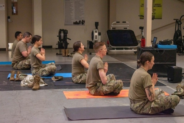 JOINT BASE LEWIS-MCCHORD, Wash.,-- Thunderbolt Soldiers use their lunch time to take advantage of a combat mobility yoga session Feb. 26, at 5th Battalion, 3rd Field Artillery Regiment headquarters. Yoga sessions are designed to improve overall mental wellness and increase core strength and mobility. (U.S. Army photo by Sgt. Casey Hustin, 17th Field Artillery Brigade)