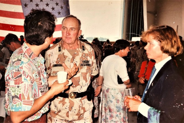 Maj. Gen. Ronald H. Griffith, 1st Armored Division commanding general, chats with a host nation guest and Frauke Davis, chief of government relations, during an event celebrating the homecoming of 1st Armored Division Soldiers to Ansbach May 8, 1991.