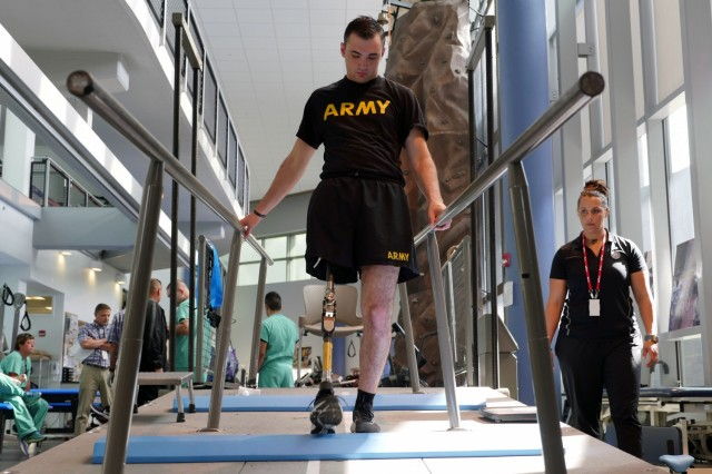 Army Spc. Ezra Maes undergoes physical rehabilitation at the Center for the Intrepid, Brooke Army Medical Center's cutting-edge rehabilitation center at Joint Base San Antonio-Fort Sam Houston, Texas, Oct. 2, 2019.