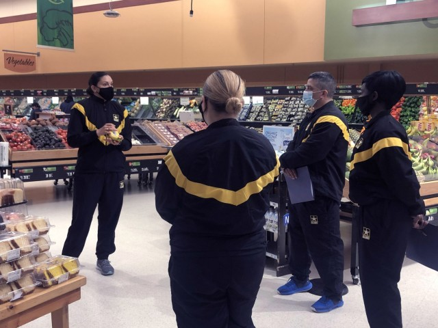 TRADOC Command Dietician, Maj. Brenda Bustillos, PhD, discusses nutritional health to the Embracing H2F program participants at the Fort Eustis, Virgina, Commissary, Feb. 22, 2021. (U.S. Army Courtesy Photo).