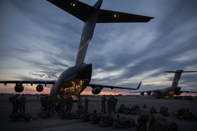 U.S. Soldiers prepare to board an Air Force C-17 aircraft at Naval Air Station – Joint Reserve Base, Fort Worth during a Joint Forcible Entry Exercise. The National Defense Center for Energy and Environment is working on three multi-service projects that will improve the safety of a parachute jumper exiting the aircraft.