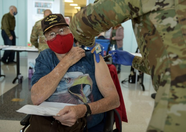 A 59th Medical Wing medic vaccinates a San Antonio Military Health System beneficiary, Feb. 6, 2021, at Wilford Hall Ambulatory Surgical Center, Joint Base San Antonio-Lackland, Texas. For more information on what tier the San Antonio Military Health System is currently vaccinating, please visit https://www.jbsa.mil/coronavirus. (U.S. Air Force photo by Staff Sgt. Amanda Stanford)