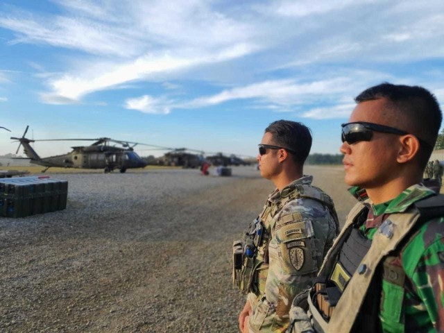 Capt. Kris Candelaria, a team leader assigned to 5th Security Force Assistance Brigade, and 1st Lt. Rendi Hardika Putera, assigned to the Indonesian Army, prepare for an air movement exercise at Fort Polk, La., Oct. 6, 2020.