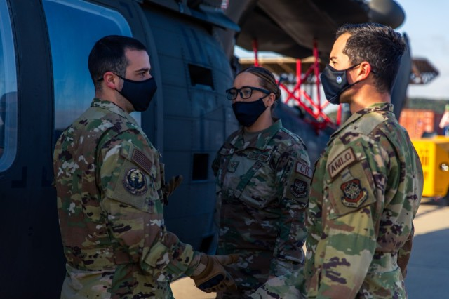 A group of Airmen, from the 621st Mobility Support Operations Squadron, discuss the process of preparing and moving the UH-60 Black Hawk onto a Lockheed C-5 Galaxy aircraft at Fort Hood, Texas, February 24, 2021.  The training was put on hold after an ice storm in Texas left many without water and power from February 11th to the 20th.  (U.S. Army Photo by Spc. Froylan Grimaldo)