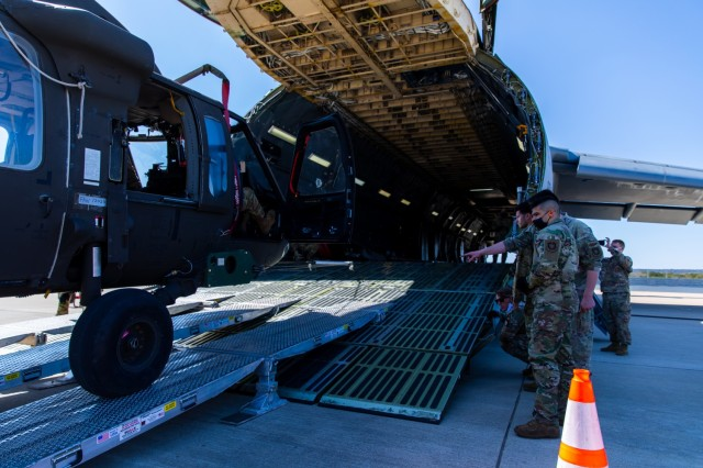 Soldiers and Airmen from 3rd Battalion, 227th Aviation Regiment, 1st Air Cavalry Brigade, 1st Cavalry Division and 621st Mobility Support Operations Squadron worked together to move the UH-60 Black Hawk into the Lockheed C-5 Galaxy aircraft at Fort Hood, Texas, February 24, 2021.  The Soldiers and Airmen keep a close eye on the cables to ensure they don't break and cause harm to anyone nearby.  (U.S. Army Photo by Spc. Froylan Grimaldo)