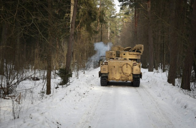 A Bradley Fighting Vehicle belonging to 2nd Battalion, 8th Cavalry Regiment, is hit by a mock improvised explosive device Feb. 21, 2021, at the Kairai Training Area, Lithuania. 2-8 Cav. Reg. Troopers traveled a two-mile route during a combined training exercise with Lithuanian 21st Dragoon Battalion to test the ability of Troopers to identify and react to an ambush and the ability of the Dragoon Battalion to slow or stop the advance of heavy weaponry. (U.S. Army photo by Sgt. Alexandra Shea)