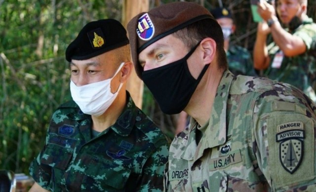 Capt. Matthew Orders, a team leader assigned to 1st Battalion, 5th Security Force Assistance Brigade, observes a training event alongside Col. Aekanan Hemabut, commander of the Royal Thai Army 111th Infantry Regimental Combat Team, Aug. 25, 2020 in Chachoengsao, Thailand.