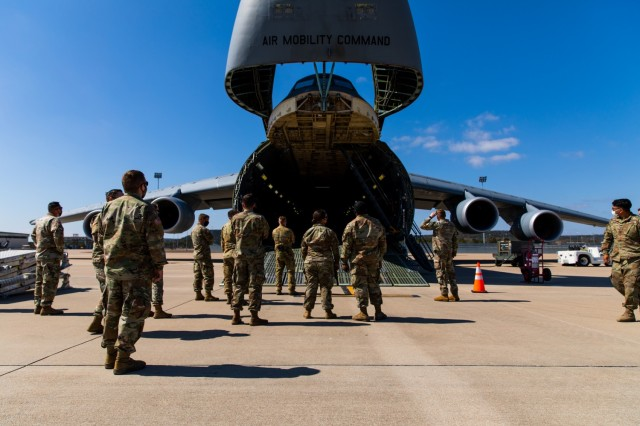 Soldiers and Airmen from 3rd Battalion, 227th Aviation Regiment, 1st Air Cavalry Brigade, 1st Cavalry Division and 621st Mobility Support Operations Squadron gathered to discuss how to move the UH-60 Black Hawk into the Lockheed C-5 Galaxy aircraft at Fort Hood, Texas, February 24, 2021.  The C-5 can hold a maximum of 5 Black Hawk Helicopters.  (U.S. Army Photo by Spc. Froylan Grimaldo)