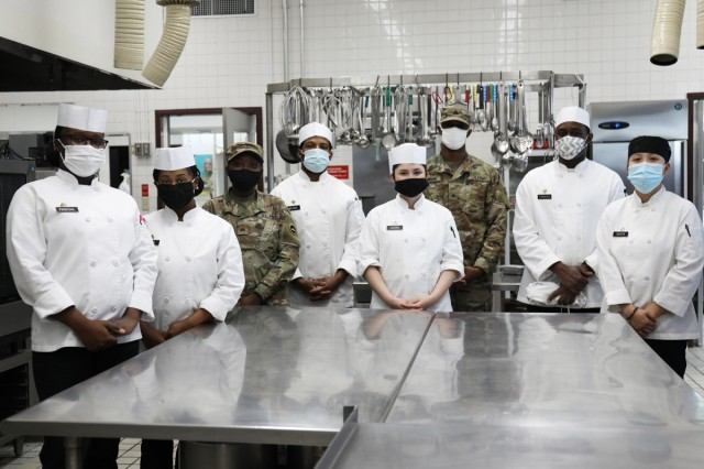 Members of the 35th Combat Sustainment Support Battalion's field feeding platoon pose for a photo Jan. 26 at the dining facility at Camp Zama, Japan. When services at the dining facility were interrupted Jan. 21, the field feeding platoon took over operations and began providing hot, takeout-only meals to customers three times a day, seven days a week.