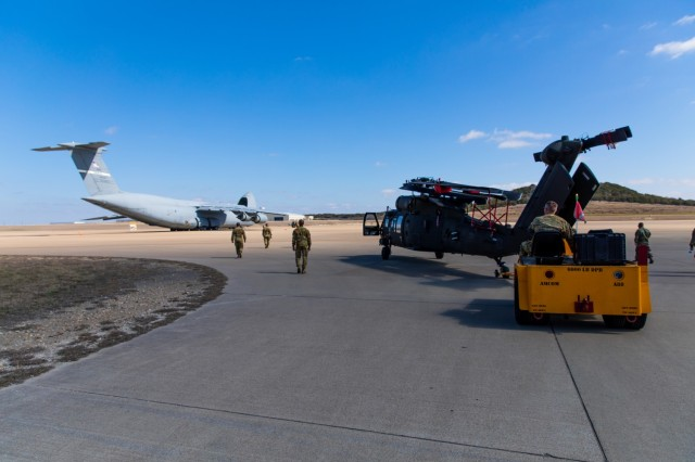 Sgt. Bryan Battaglia, a Maintenance Supervisor from 3rd Battalion, 227th Aviation Regiment, 1st Air Cavalry Brigade, 1st Cavalry Division, helps to move the UH-60 Black Hawk to the Lockheed C-5 Galaxy aircraft at Fort Hood, Texas, February 24, 2021.  The Black Hawk Helicopter weighs approximately 11,500 pounds and can carry a maximum gross weight of 22,000 pounds.  (U.S. Army Photo by Spc. Froylan Grimaldo)