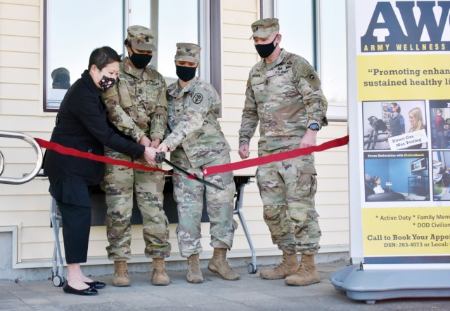 From left, Shannon Vo, director of the Camp Zama Army Wellness Center; U.S. Army Medical Department Activity – Japan Command Sgt. Maj. Tanya Boudreaux; Col. Tanya Peacock, commander of MEDDAC-J; and U.S. Army Japan Command Sgt. Maj. Jerry Dodson, cut the ribbon at the grand reopening of the Camp Zama AWC in Bldg. 379, Camp Zama, Japan, Feb. 25.