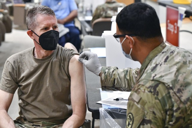 Command Sgt. Maj. Clark Charpentier, U.S. Army Medical Center of Excellence Command Sergeant Major is administered the COVID-19 vaccine by Sgt. Matthew Harris at Brooke Army Medical Center on Joint Base San Antonio-Fort Sam Houston, Texas on February 1, 2021.