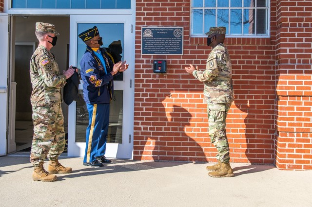 Maj. Gen. Patrick J. Donahoe, commanding general of the Maneuver Center of Excellence and Fort Benning, Command Sgt. Maj. Derrick C. Garner, command sergeant major of the U.S. Army Maneuver Center of Excellence, and Darrel Nash unveiled the plaque for the 24th Infantry Regiment Post Exchange.
