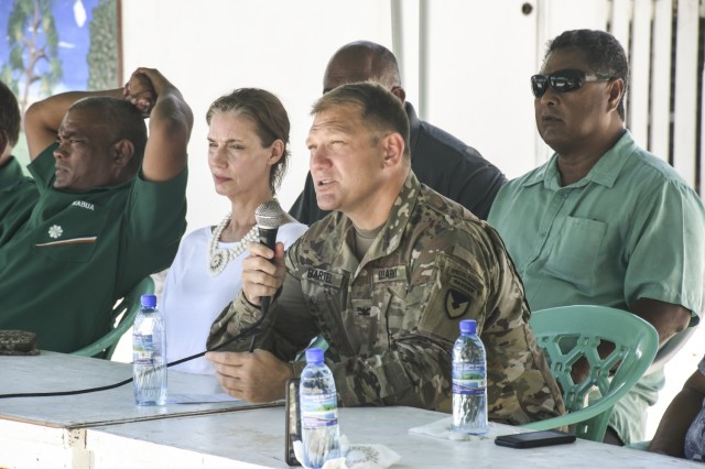 Col. Jeremy Bartel, USAG-KA commander, presents opening remarks at a June 1, 2020 town hall meeting on Ebeye with U.S. Ambassador to the Republic of the Marshall Islands Roxanne Cabral, center. (U.S. Army photo by Jessica Dambruch)