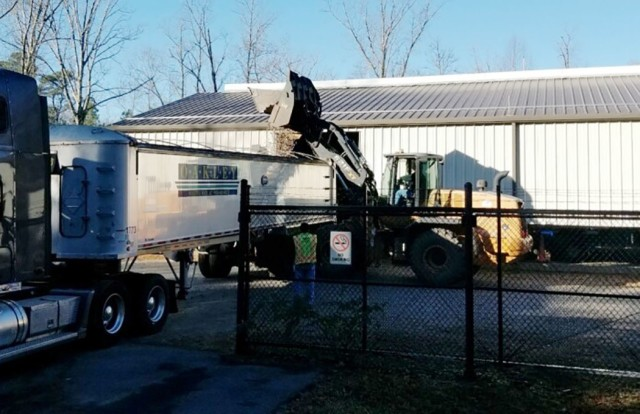 A bucket loader dumps brass into a trailer bed so it can be hauled away for recycling. The program is part of the Qualified Recycling Program here. It is managed by the Directorate of Public Works Environmental Management Division with support from Logistics Readiness Center - Lee and Mission Integrated Contracting Command – Lee. (U.S. Army Photo)
