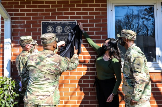Maj. Gen. Patrick J. Donahoe, commanding general of the Maneuver Center of Excellence and Fort Benning, and Command Sgt. Maj. Derrick C. Garner, command sergeant major of the U.S. Army Maneuver Center of Excellence,unveil the plaque at the residence of then Maj. Colin Powell.
