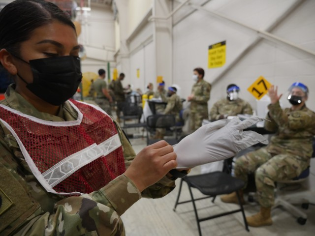 Soldiers prepare to administer the COVID-19 vaccine on February 22, 2021 at the new Fort Sam Houston Vaccine Site located at the Training Support Center, Building 4110, 2536 Garden Avenue, Joint Base San Antonio-Fort Sam Houston. The U.S. Army Medical Center of Excellence will provide augmented support to Brooke Army Medical Center (BAMC) with several dozen vaccinators, screeners, medical administrators, and medical providers at any given time on a rotational basis in support of the tasking that could last up to six months. Augmenters, that include medical military occupational specialties like Combat Medics (68W), Practical Nursing Specialists (68C), and Army Physician Assistants (65D), were given training by BAMC staff on the proper screening, preparation and vaccine administration procedures in advance of the tasking.