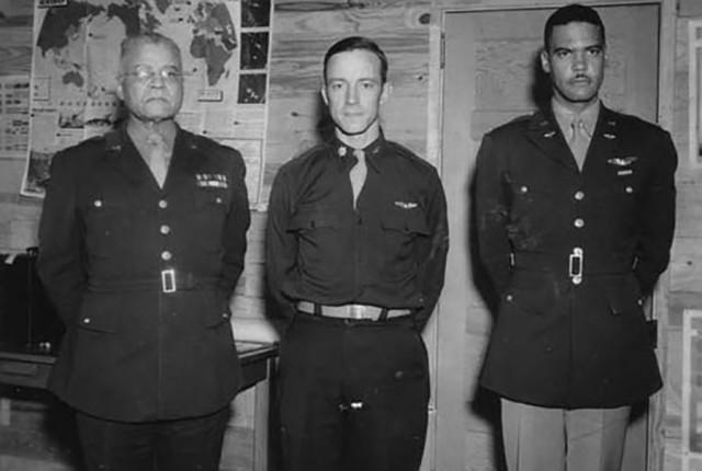 Brig. Gen. Benjamin O. Davis Sr., Lt. Col. Noel F. Parrish, and Lt. Col. Benjamin O. Davis Jr. pose for a commemorative image during World War II. Lt. Col. Davis went on to earn his fourth star in 1988. (U.S. Army Photo)