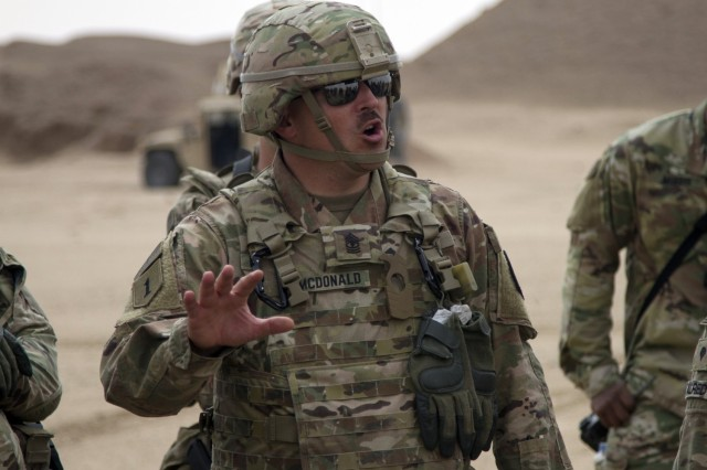 First Sgt. Brady McDonald, assigned to the 145th Field Artillery Regiment, addresses his Soldiers during Operation Diamond Strike near Camp Buehring, Kuwait, Feb. 28, 2018. The First Sergeant Talent Alignment Assessment held a recent pilot with about a dozen master sergeants at Fort Bragg, North Carolina, and now plans to expand the program to other installations in 2021, as part of the Army's effort to place the right Soldiers in first sergeant slots.