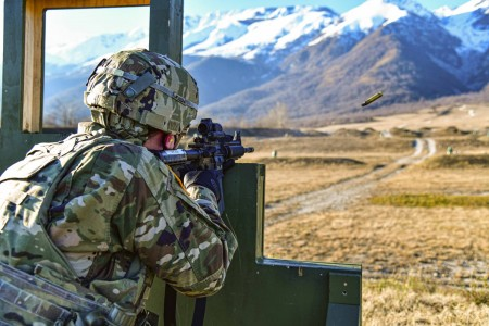 A Soldier assigned to U.S. Army Southern European Task Force, Africa engages pop-up targets with an M4 carbine during marksmanship training at Cao Malnisio Range in Pordenone, Italy, Jan. 26, 2021.