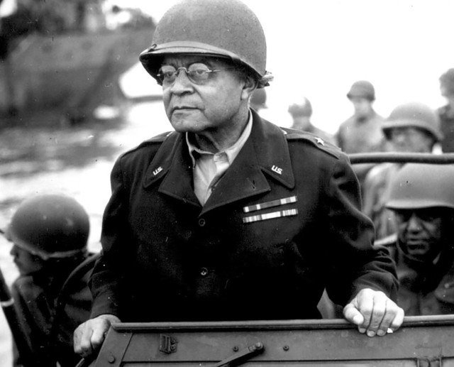 Brig. Gen. Benjamin O. Davis Sr. watches a Signal Corps crew as it erects equipment somewhere in France on Aug. 8, 1944. He was the military's first black general. His son, Benjamin O. Davis Jr., became the first black Air Force general in 1960. (U.S. Army Photo)