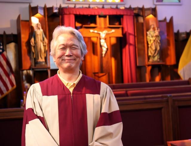 Shunji Sakita, director of the choir for the Holy Family Catholic Community, poses for a photo before Mass at the Camp Zama Chapel, Camp Zama, Japan, Feb. 21.