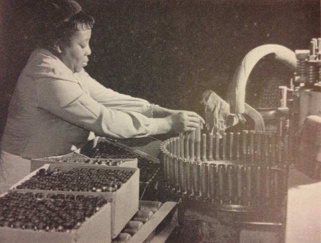 Employee on production line at Kingsbury Ordnance Depot