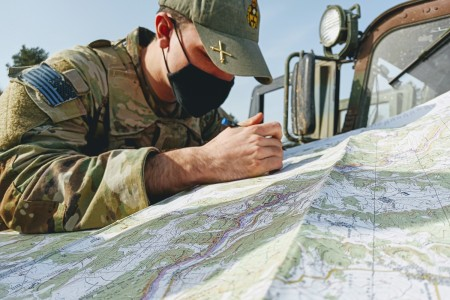 "2nd Battalion 5th Cavalry Regiment, 1st Armored Brigade Combat Team Forward Observer plots points on a map to find his way during exercise Combined Resolve, 27 Feb. 1st ABCT, ""IRONHORSE"", 1st Cavalry Division conducted exercise Combined Resolve alongside their European partner allies at the Joint Multinational Training Center Hohenfels, Germany, as part of their larger rotation in support of Atlantic Resolve"