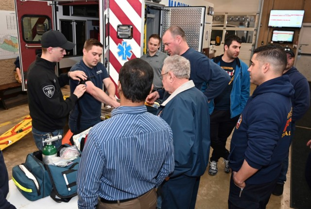Cadet Damitz, far left, runs an instructional session on emergency medical treatment for personnel from the Western Salisbury Volunteer Fire Company, where he serves as the Medical Officer.