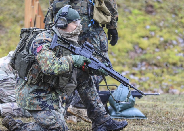 LANDSTUHL, Germany – A German Armed Forces Soldier watches as others engage targets during the German Armed Forces Badge of Marksmanship, or Schützenschnur, at Breitenwald Range, Feb. 5. U.S. Soldiers joined German Armed Forces (Bundeswehr) Service Members for a chance to earn the badge.