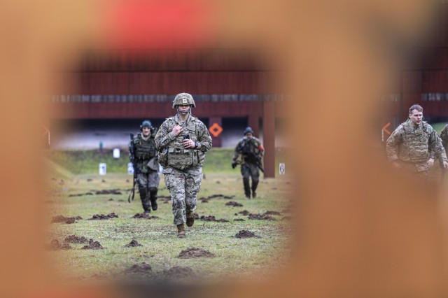 LANDSTUHL, Germany – U.S. Soldiers return from the firing line after engaging targets during the German Armed Forces Badge of Marksmanship, or Schützenschnur, at Breitenwald Range, Feb. 5. U.S. Soldiers joined German Armed Forces (Bundeswehr) Service Members for a chance to earn the badge.