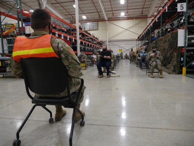 Military and civilian personnel wait the required 15-30 minutes after receiving their COVID-19 vaccination shot at the Fort Sam Houston COVID Vaccine Site, which is located in Building 4110, 2536 Garden Ave. The new location is currently taking personnel in categories 1a 1b in addition to civilian TRICARE beneficiaries 65 and older by appointment only, 8 a.m. to 4 p.m. Monday through Friday. (U.S. Army photo by Corey Toye)