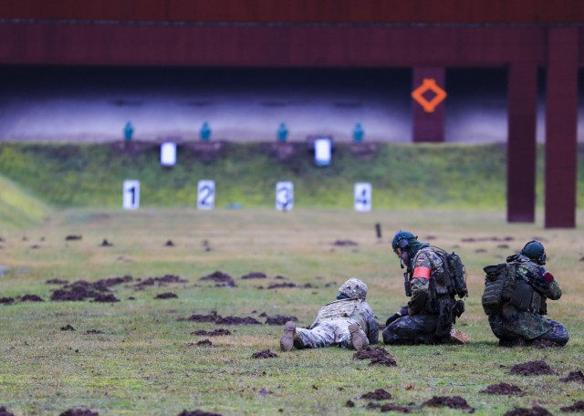 LANDSTUHL, Germany – U.S. Soldiers engage targets during the German Armed Forces Badge of Marksmanship, or Schützenschnur, at Breitenwald Range, Feb. 5. U.S. Soldiers joined German Armed Forces (Bundeswehr) Service Members for a chance to earn the badge.