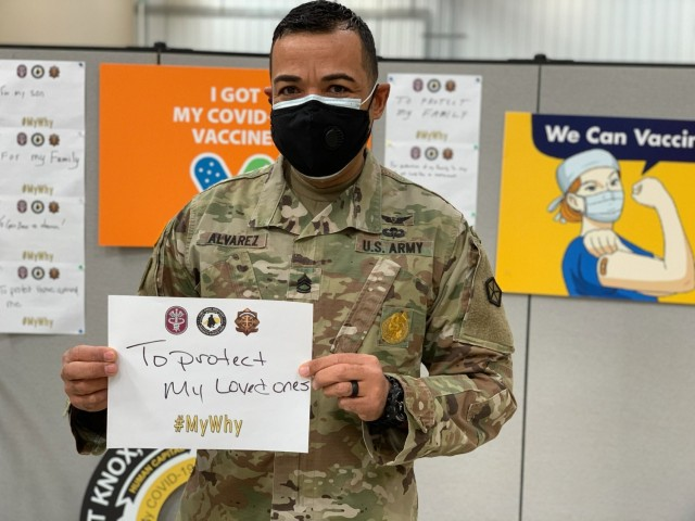 V Corps Soldier Luis Alvarez displays his reason for getting a voluntary vaccination shot 25 Feb 2021 at the Fort Knox vaccination site.