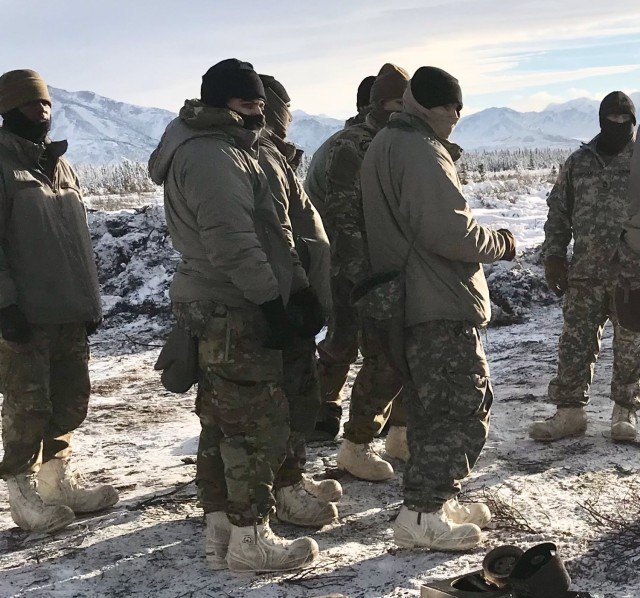 A Role 1 medic from 4th Brigade, 25th Infantry Division, and Master Sgt. David Edwards, ACM-AHS, conduct information collection training on AHS from a line medic, and Role 1 perspective, at Fort Greely, Alaska, February 6-12, 2021, in order to resolve Arctic Warfare gaps, enhance readiness, and inform modernization.