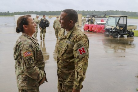Chief Warrant Officer 5 Teresa Domeier, command chief warrant officer of the Army National Guard, speaks with Maj. Thomas Traylor of the Nebraska National Guard during the Guard's hurricane recovery efforts in North Carolina on Sept. 16, 2018. Domeier is a native of Ceresco, Neb., and is the first female command chief warrant officer in the Guard's history.