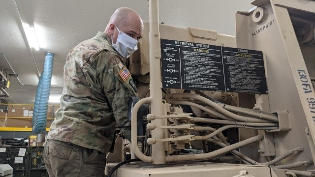 HAYS, Kan. – Sgt. 1st Class Lyndon Ellis, Field Maintenance Shop 1 mechanic, conducts routine preventive maintenance checks and services Jan. 28, 2021. FMS 1 took first place at the National Guard Bureau for the annual Army Award for Maintenance Excellence in December 2020 in the Tables of Distribution and Allowances category.