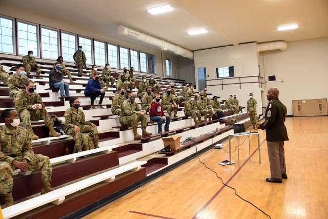 Command Sgt. Maj. Finis A. Dodson, command sergeant major, U.S. Army Space and Missile Defense Command, speaks to and visits with ROTC students from Alabama A&M University, Athens State University, and the University of Alabama-Huntsville at Alabama A&M University's Frank Lewis Gymnasium, Feb. 11.