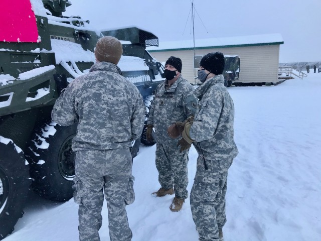A medic from Role 1, 1st Stryker Brigade Combat Team, 25th Infantry Division, Master Sgt. David Edwards, ACM-AHS, and a medic from Role 1, 1/25 SBCT, conduct assessment training on an M1133 Stryker MEV (medical evacuation vehicle) in extreme cold weather at Fort Greely, Alaska,  February 6-12, 2021, in order to resolve Arctic Warfare gaps, enhance readiness, and inform modernization.