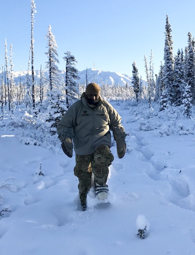 Lt. Col. Cleve Sylvester, Army Capability Manager-Army Health System, uses Army issued snowshoes to maneuver in the training area during his support of Arctic Warrior 2021 in Fort Greely, Alaska.