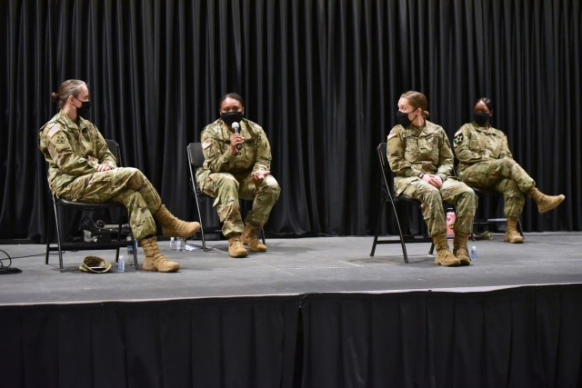 Capt. Cotrena Brown-Johnson, second from the left, answers a question during the Women's History Month panel discussion.