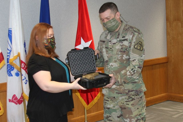 Julie Ferrigno (left), Accountable Officer for Tank-automotive and Armaments Command General Officer Pistol Program, issues a SIG Sauer Modular Handgun System to Brig. Gen. Glenn Dean, Program Executive Officer Ground Combat Systems (right) on Feb. 25 at the Detroit Arsenal, Mich.