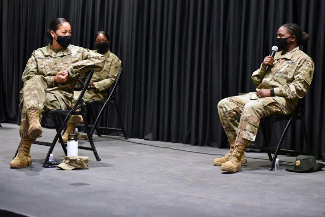 Drill Sgt. Sahara McCrary, far right, shares her experiences with the audience during the MEDCoE Women's History Month panel discussion while 1st Sgt. Annie Thornton and Command Sgt. Maj. Deanna Carson look on.