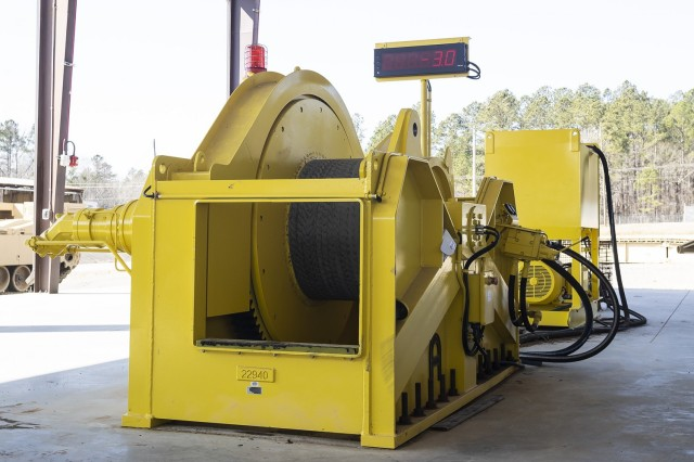 A 100-ton anchor winch sits inside of Anniston Army Depot's M88 winch test facility. The anchor winch replaces an outdated winch test method, which connected multiple vehicles to the M88 to test its pull capacity.