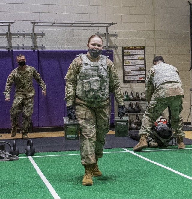 """Soldiers assigned to units at Fort Eustis, Virginia, participate in realistic Army Combat Fitness Test, or ACFT, training to represent battlefield conditions, Feb. 26, 2021. Pfc. Savanna Pendergrass, 10th Transportation Battalion, carries 35 pound ammunition cans during the """"sprint, drag, carry"""" portion of the ACFT. (U.S. Army photo by David Overson)"""